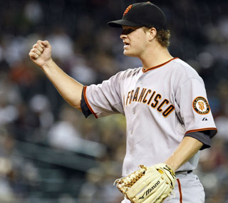 Matt Cain pitches eight strong innings as he leads the Giants to a 3-0 shutout victory.  (AP)