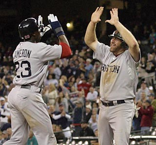 Mike Cameron (23) and Kevin Youkilis celebrate after scoring the go-ahead runs in the 13th.  (US Presswire)