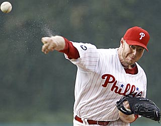 Roy Halladay strikes out nine and only walks one in eight innings against the Rockies. (AP)