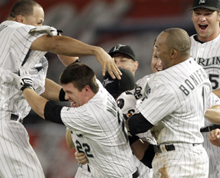 Donnie Murphy(22) celebrates his second walk-off hit of the week with his teammates. (AP)