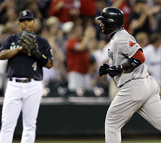 Bill Hall's solo home run to lead off the seventh inning is the difference for the Red Sox.  (AP)