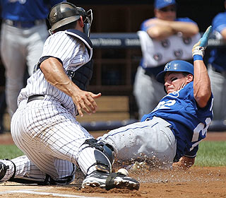 Safe! Jorge Posada is unable to hold onto the ball as Scott Podsednik slides home in the first inning.  (Getty Images)