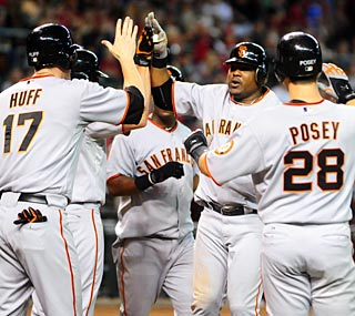 Juan Uribe hits his fourth career grand slam to help the Giants pound the Diamondbacks.  (US Presswire)