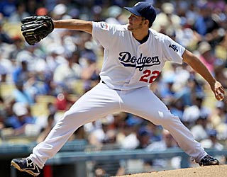 Clayton Kershaw strikes out three and retires 12 batters in a row in eight shutout innings. (Getty Images)