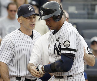 A-Rod dodges a serious injury when a pitch deflects off his left hand in a bases-loaded at-bat in the eighth.  (AP)