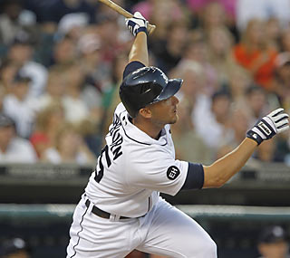Ryan Raburn boosts the Tigers with a clutch bases-clearing double off reliever Jason Frasor.  (AP)