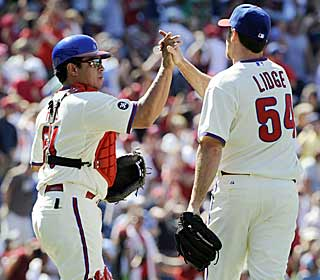 Carlos Ruiz congratulates Brad Lidge, who works out of a bases-loaded jam to get the save.  (US Presswire)