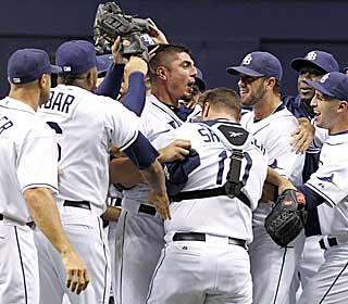 Matt Garza celebrates with teammates after tossing the fifth no-hitter of the season. (AP)