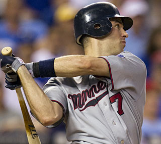 Defending AL MVP Joe Mauer batters the Royals all night, going 5 for 5 with seven RBI. (AP)