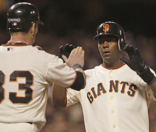 Edgar Renteria connects on a rare home run to help the Giants rally out three runs in the eighth.  (AP)