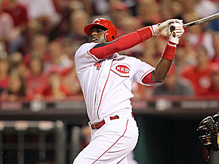 Brandon Phillips hits his fourth career grand slam to help the Reds beat Brewers. (Getty Images)