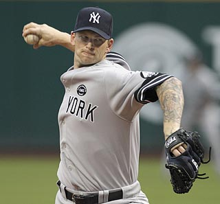 A.J. Burnett scatters seven hits and strikes out seven to earn his first career victory in Cleveland.  (AP)