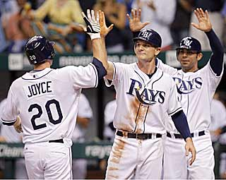 It's high-fives for Matt Joyce after he hits the go-ahead home run in the sixth for the Rays. (AP)