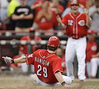 Ryan Hanigan scores after hitting a double and getting some help from a Melky Cabrera throwing error. (AP)