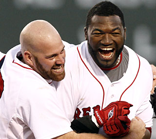 Kevin Youkilis embraces David Ortiz after Big Papi's bases-loaded double in the bottom of the ninth.  (AP)