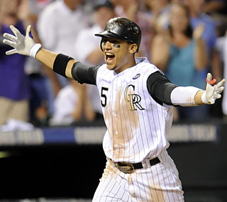 Carlos Gonzalez slams a mammoth 462-foot homer to earn the cycle and the dramatic win for the Rockies.  (AP)