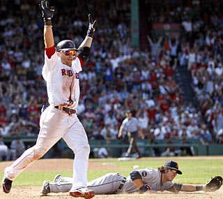 Marco Scutaro's sacrifice bunt in the ninth turns out to be the game winner for the Red Sox.  (AP)