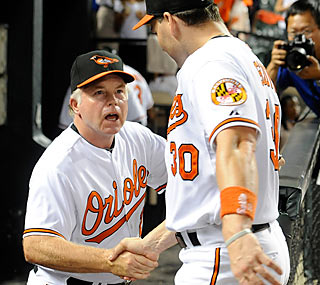 Luke Scott (right) congratulates new skipper Buck Showalter for winning in his Orioles debut.  (Getty Images)