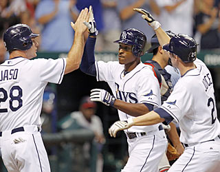 B.J. Upton (center) receives congratulations for a three-run HR, which represents half of the Rays' runs.  (AP)