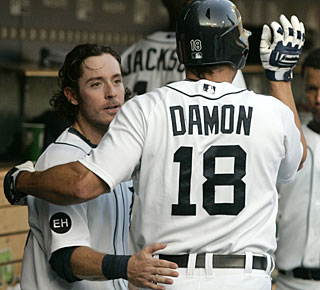 Johnny Damon shows no signs of a sore back that kept him out for three games and goes 3 for 5 in Game 2. (AP)