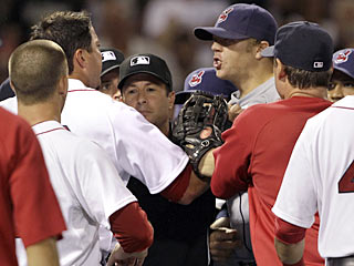 Cleveland's Shelley Duncan (right) and Josh Beckett (left) share words as the Red Sox beat the Indians. (AP)