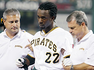 A disoriented Andrew McCutchen walks off the field under his own power after being struck quite hard. (AP)
