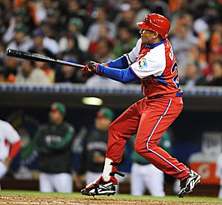 Cuba's Frederich Cepeda breaks a 2-2 tie with a three-run double in the fifth inning.  (US Presswire)