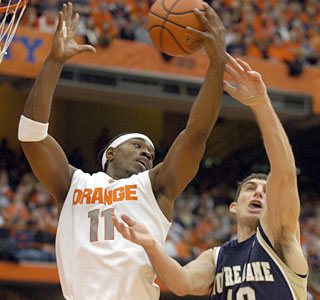 Paul Harris pulls down one of his 10 rebounds to go along with 15 points for Syracuse.  (AP)