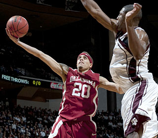 Austin Johnson leads the Sooners with 19 points in a victory over the host Aggies.  (AP)