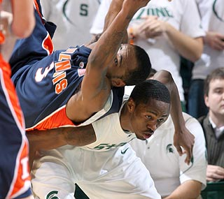 Illinois' Chester Frazier and Michigan State's Kalin Lucas get tangled up in this Big Ten battle.  (AP)