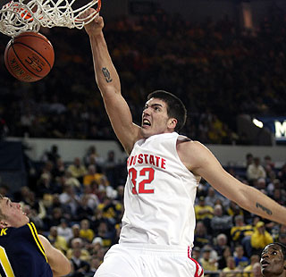 Buckeyes freshman B.J. Mullens slams home two of his 15 points in the victory at Ann Arbor.