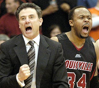 Rick Pitino celebrates taking the lead in the final minutes as Louisville goes to 6-0 in the Big East.  (AP)