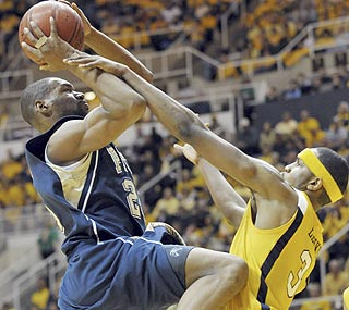 Sam Young takes advantage of one-on-one defense to score 22 points on the Mountaineers.  (AP)