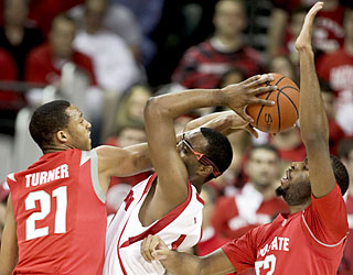 The Buckeyes try to put the clamps on Marcus Landry (17 points) and the Badgers, but fall just short.  (AP)