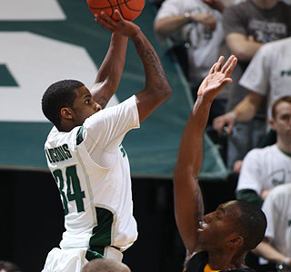 Korie Lucious drops 12 points as No. 9 Michigan State increases its Big Ten lead. (AP)