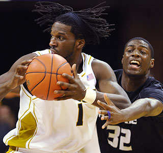 You're not getting the rock: DeMarre Carroll (21 points) plays keepaway from Jamar Samuels. (AP)