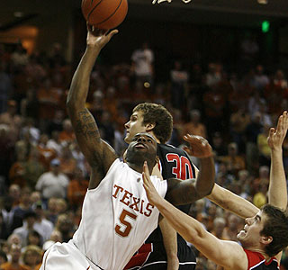 Damion James shoots for two of his 20 points and adds 11 rebounds in the Texas victory.