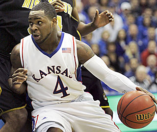 Sherron Collins contributes 25 points as Kansas rolls over its cross-border rival from Missouri.  (AP)