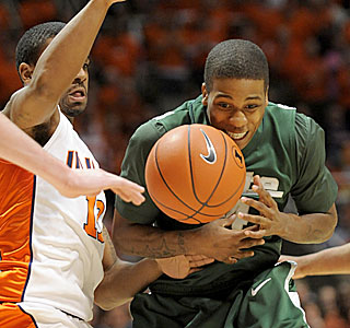 Michigan State's Korie Lucious tries to find the handle while the Illinois defense closes in.  (AP)