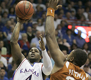 Sherron Collins puts up 21 points and seven assists in KU's 41st straight home win.  (AP)