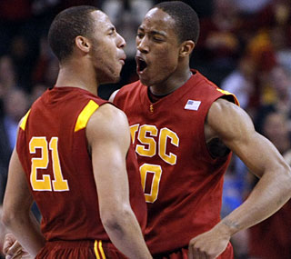 DeMar DeRozan (right) nets 21 points and grabs 13 rebounds to lead the upset of UCLA.  (AP)
