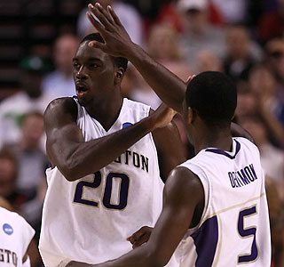 The Huskies' Quincy Pondexter (20) gets some love during his 23-point performance.  (Getty Images)