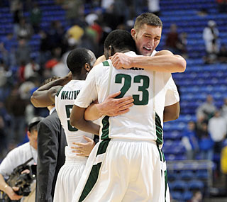 Draymond Green and Goran Suton embrace after Michigan State withstands feisty USC.  (US Presswire)