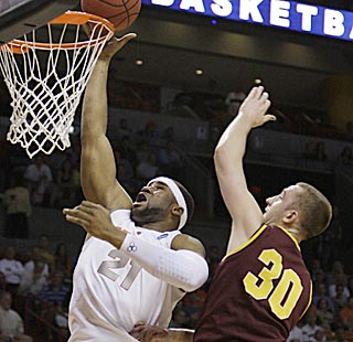 Rihards Kuksiks and Arizona State can do little to stop Arinze Onuaku, who makes six of eight shots.  (AP)