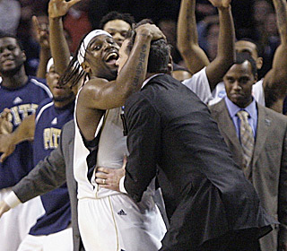 Levance Fields and Jamie Dixon celebrate as the Panthers make their first regional final since '74.
