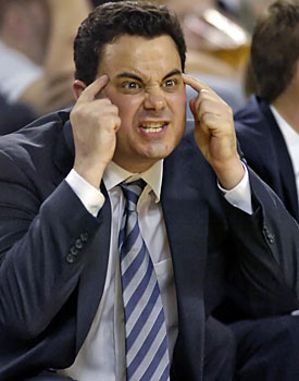 Many coaches, like Arizona's Sean Miller, have left smaller conferences for greener pastures. (US Presswire)