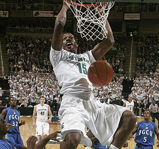 Dunk time: Michigan State's Durrell Summers slams home two of his 14 first-half points.  (AP)
