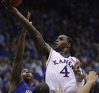 Sherron Collins scores 23 points as No. 1 Kansas wins its 37th consecutive home opener.  (AP)