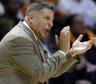 Bruce Pearl is pleased with the effort that makes him the second-fastest Vols coach to 100 wins. (AP)