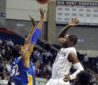 Jerome Dyson, attempting a shot here, finishes with 23 points for the Huskies. (AP)